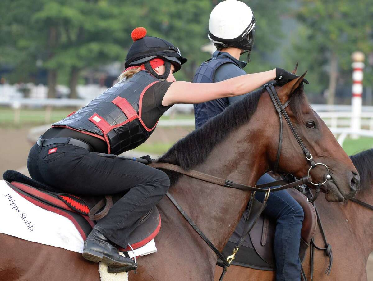 Exercise rider Jen Patterson fixes Kentucky Derby winner Orb's forelock before his final major work on the Oklahoma Training Center track Monday morning, Aug. 19, 2013, in Saratoga Springs, N.Y. Orb will compete in Saturday's Travers Stakes at Saratoga Race Course. (Skip Dickstein/Times Union)
