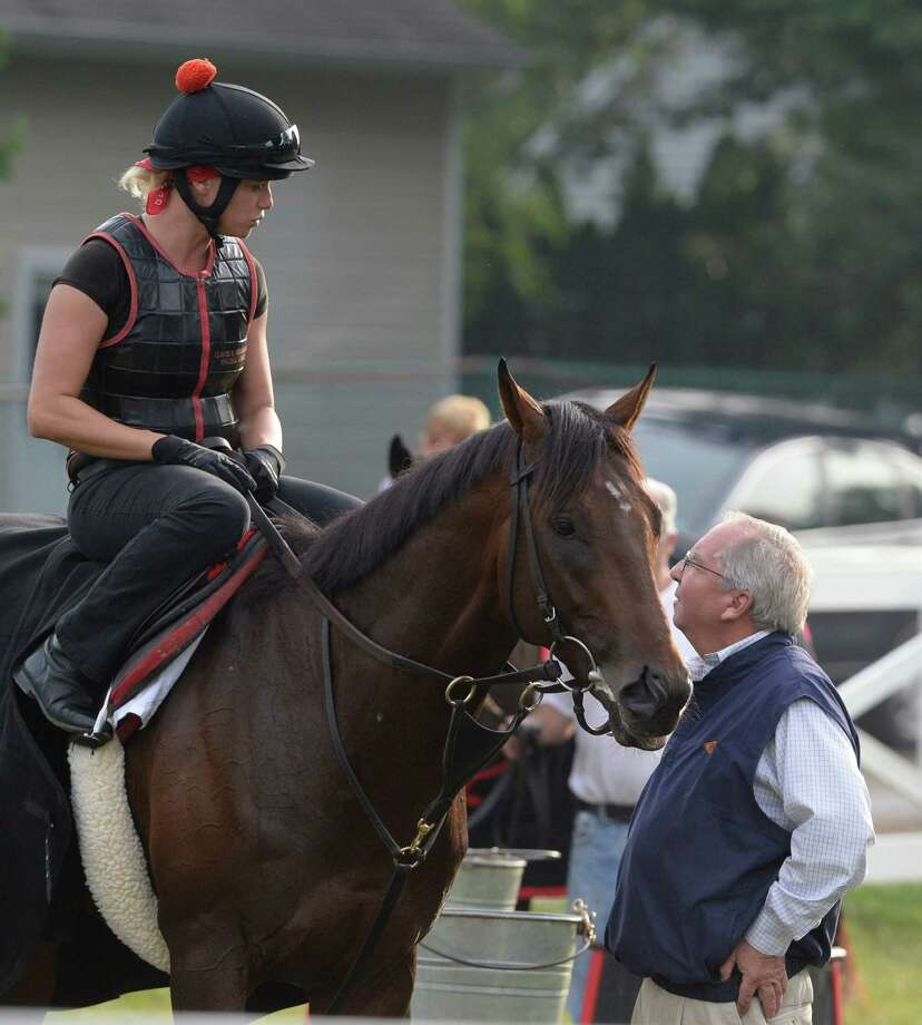Exercise rider Jen Patterson, aboard Kentucky Derby winner Orb, speaks to trainer Shug McGaughey Monday morning, Aug 19, 2013, following Orb's final major work at the Oklahoma Training Center track in Saratoga Springs, N.Y.  Orb will compete in Saturday's Travers Stakes at Saratoga Race Course.  (Skip Dickstein/Times Union) Photo: SKIP DICKSTEIN