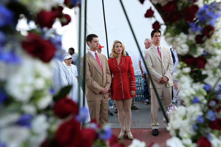 USA performers wait backstage during a ceremony at the Intrepid Sea, Air & Space Museum marking the 70th anniversary of the ship's commissioning Friday, Aug. 16, 2013 in New York.  (AP Photo/Mary Altaffer) ORG XMIT: NYMA103 Photo: Mary Altaffer, AP / AP