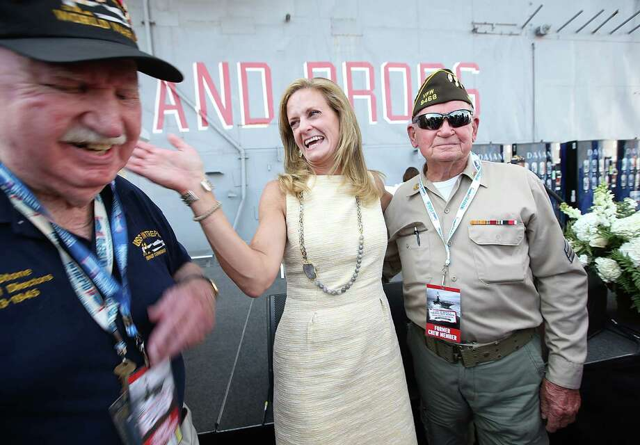 NEW YORK, NY - AUGUST 16:  Former crew members Ray Stone (L) and James Bishop Jr. (R) share a laugh with Intrepid Museum President Susan Marenoff-Zausner on the flight deck at the U.S.S. Intrepid 70th Anniversary Commissioning Ceremony on August 16, 2013 in New York City. The Intrepid Sea, Air & Space Museum celebrated the 70th anniversary of the aircraft carrier's Commissioning with nearly 300 former U.S.S. Intrepid crew members from World War II, the Korean War, the Cold War and the Vietnam War.  (Photo by Mario Tama/Getty Images) ORG XMIT: 176794029 Photo: Mario Tama, Getty / 2013 Getty Images