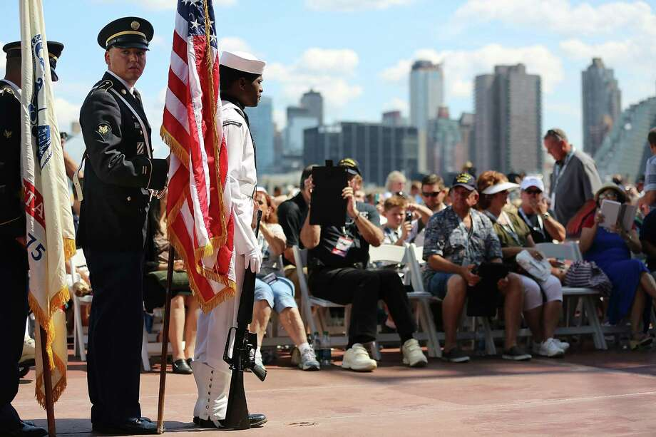 NEW YORK, NY - AUGUST 16:  The New York City Joint Services Color Guard wait to present the colors on the flight deck at the U.S.S. Intrepid 70th Anniversary Commissioning Ceremony on August 16, 2013 in New York City. The Intrepid Sea, Air & Space Museum celebrated the 70th anniversary of the aircraft carrier's Commissioning with nearly 300 former U.S.S. Intrepid crew members from World War II, the Korean War, the Cold War and the Vietnam War.  (Photo by Mario Tama/Getty Images) ORG XMIT: 176794029 Photo: Mario Tama, Getty / 2013 Getty Images