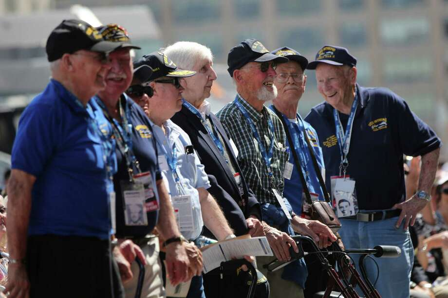 World War II veterans smile as they are acknowledged during a ceremony at the Intrepid Sea, Air & Space Museum marking the 70th anniversary of the ship's commissioning Friday, Aug. 16, 2013 in New York.  (AP Photo/Mary Altaffer) ORG XMIT: NYMA105 Photo: Mary Altaffer, AP / AP