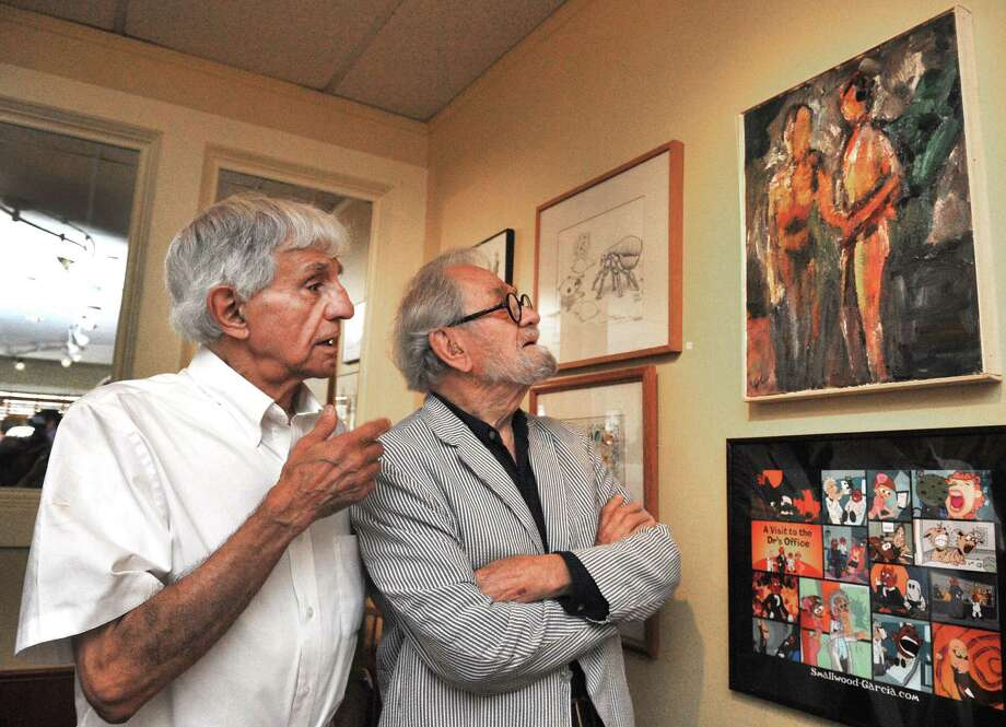 "Joseph Farris, left, and Frederick Carpenter, discuss Carpenter's painting,"" Lovers,"" at the opening reception of The Artists of Plain Jane's Art Show, in Bethel, Conn. Sunday, Aug. 18, 2013. Photo: Michael Duffy / The News-Times"