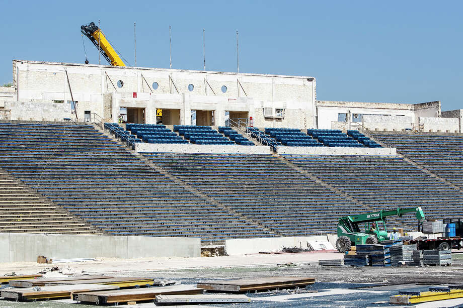 Work continues on the $35 million Alamo Stadium renovation project on Aug. 7, 2013. The pressbox area at the entrance to the stadium has been removed. Photo: MARVIN PFEIFFER, Marvin Pfeiffer / Prime Time New / Prime Time Newspapers 2013