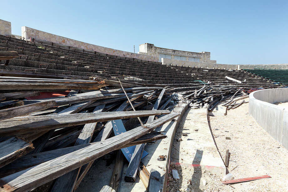 Wooden bleachers are dismantled in the south end of Alamo Stadium while work continues on the renovation project on Aug. 7, 2013. Photo: MARVIN PFEIFFER, Marvin Pfeiffer / Prime Time New / Prime Time Newspapers 2013