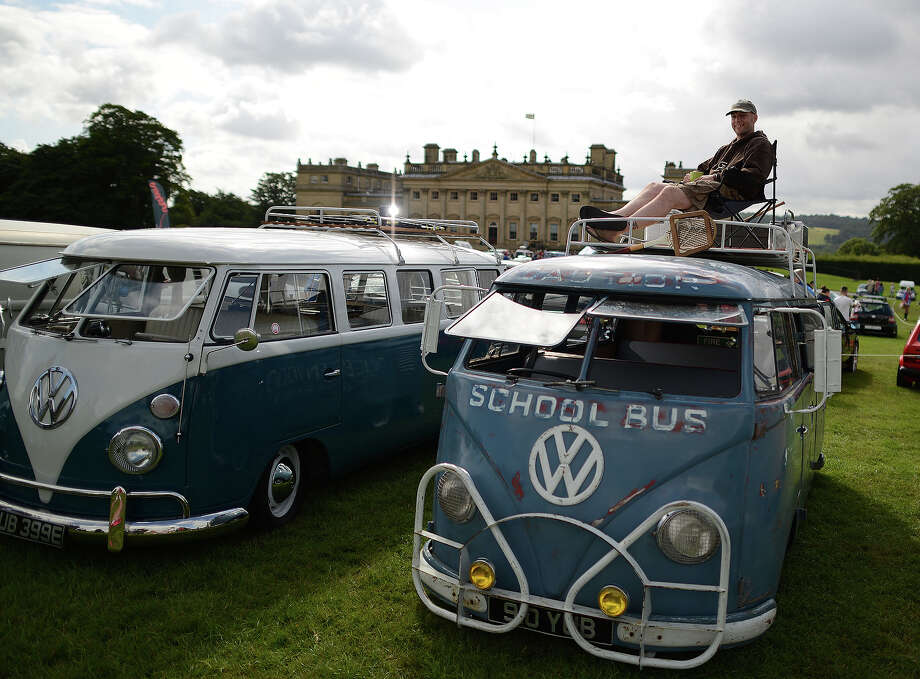 Volkswagen Westies, Vanagons, Buses and the like on display at the annual 'In Praise Of All Things VW At The Annual Festival' in England: Sooty Shuttleworth of Bingley sits on his 1957 VW splitscreen, a former Queenwood school bus in Australia on display during the 'In Praise Of All Things VW At The Annual Festival' at Harewood House on August 18, 2013 in Leeds, England. The annual VW festival is in its 9th year attracting around 15,000 people over the weekend, ending with the winners car parade on Sunday. Photo: Nigel Roddis, Getty Images / 2013 Getty Images