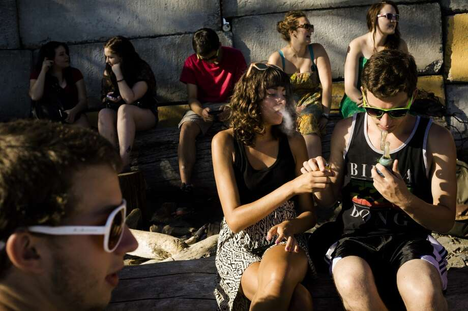 Groups of young folks pass a pipe back and forth, smoking up their spot on the waterfront during the third and final day of Seattle Hempfest Sunday, August 18, 2013, at Myrtle Edwards Park in Seattle. (Jordan Stead, seattlepi.com) Photo: JORDAN STEAD, SEATTLEPI.COM