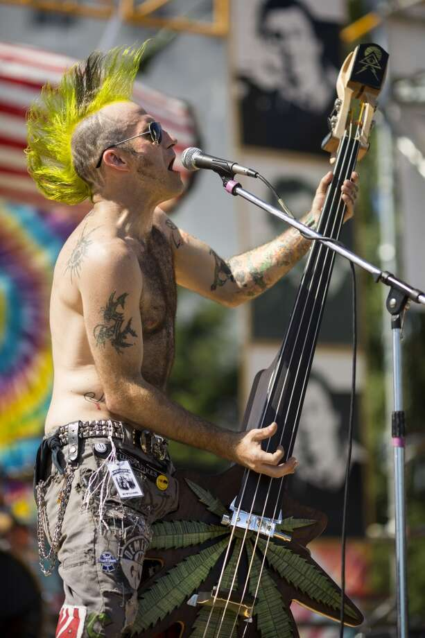 Squirrel, bassist for Angie & The Car Wrecks, plays his way through their set on his weed leaf shaped instrument on the third and final day of Seattle Hempfest Sunday, August 18, 2013, at Myrtle Edwards Park in Seattle. (Jordan Stead, seattlepi.com) Photo: JORDAN STEAD, SEATTLEPI.COM