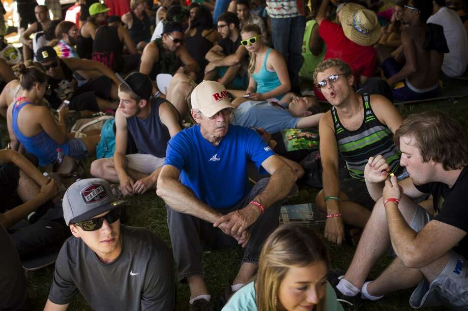 Festivalgoers smoke under the shade of a tent on the third and final day of Seattle Hempfest Sunday, August 18, 2013, at Myrtle Edwards Park in Seattle. (Jordan Stead, seattlepi.com) Photo: JORDAN STEAD, SEATTLEPI.COM