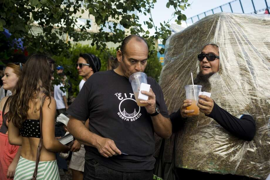 A man dressed as an edible makes his way through the crowds on the third and final day of Seattle Hempfest Sunday, August 18, 2013, at Myrtle Edwards Park in Seattle. (Jordan Stead, seattlepi.com) Photo: JORDAN STEAD, SEATTLEPI.COM