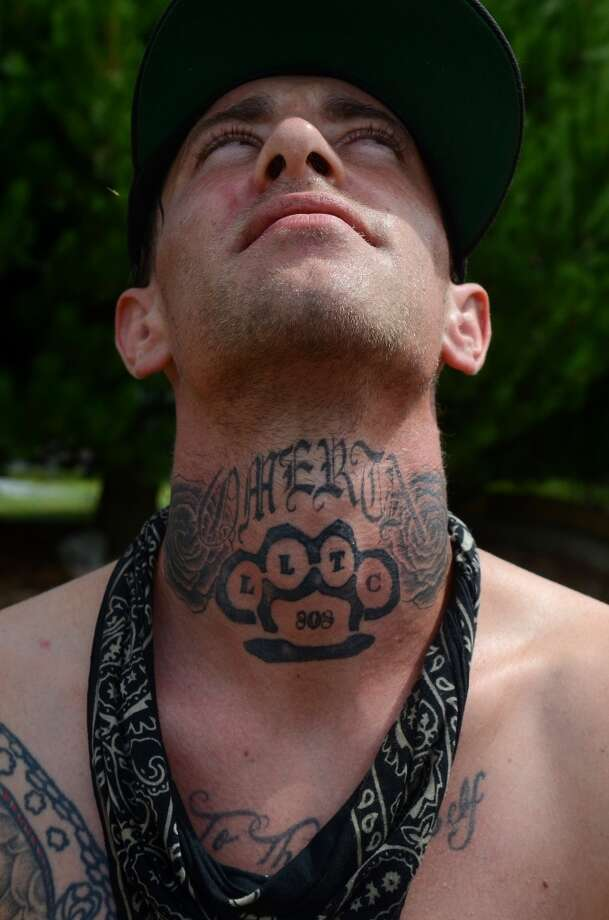 Ryan Reginato shows off his neck tattoo during the second day of the annual Hempfest Saturday, Aug. 17, 2013. This is the first year for the annual pro-pot rally since Washington State voters legalized recreational use of marijuana. (Sy Bean, seattlepi.com) Photo: SY BEAN, SEATTLEPI.COM