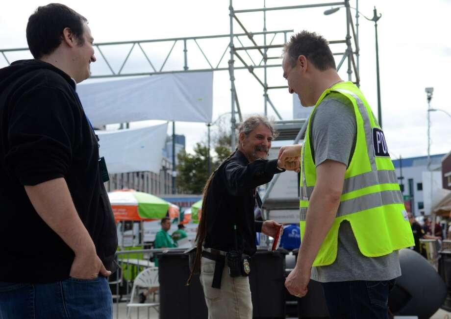 Seattle Police Sgt. Sean Whitcomb is thanked by Vivian McPeak, Hempfest executive director after police passed out bags of Doritos affixed with a sticker that helps spell out rules for marijuana users during the second day of Seattle's annual Hempfest Saturday, Aug. 17, 2013. This is the first year for the annual pro-pot rally since Washington State voters legalized recreational use of marijuana. (Sy Bean, seattlepi.com) Photo: SY BEAN, SEATTLEPI.COM