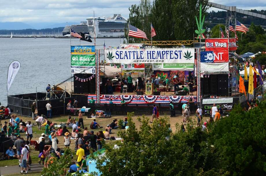 Attendees sit near the main stage during the second day of the annual Hempfest Saturday, Aug. 17, 2013. This is the first year for the annual pro-pot rally since Washington State voters legalized recreational use of marijuana. (Sy Bean, seattlepi.com) Photo: SY BEAN, SEATTLEPI.COM