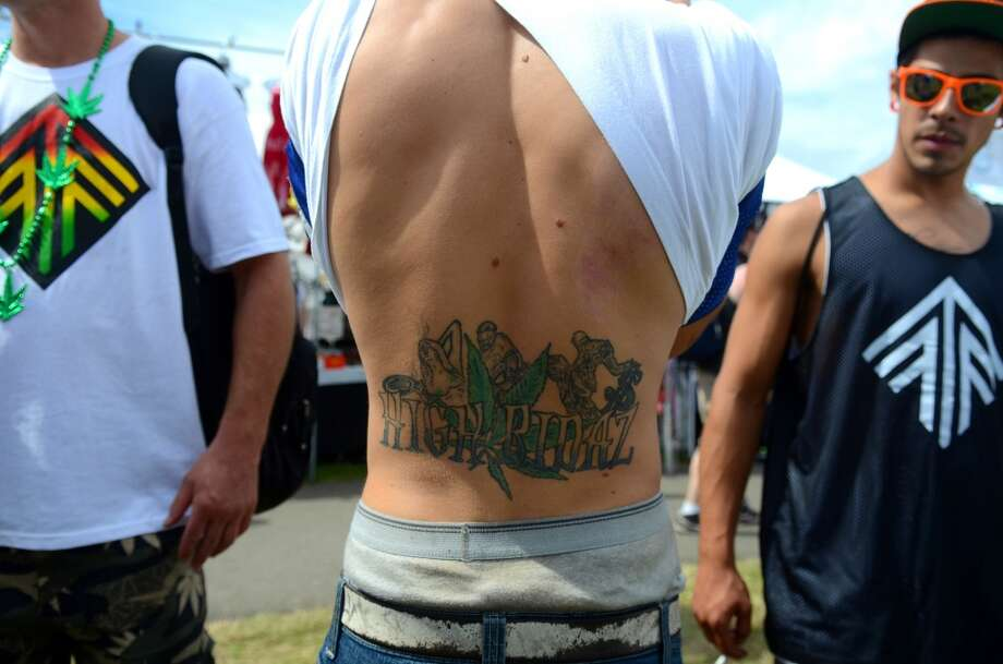 "An attendee shows off his tattoo which reads ""High Ridaz"" during the second day of the annual Hempfest Saturday, Aug. 17, 2013. This is the first year for the annual pro-pot rally since Washington State voters legalized recreational use of marijuana. (Sy Bean, seattlepi.com) Photo: SY BEAN, SEATTLEPI.COM"