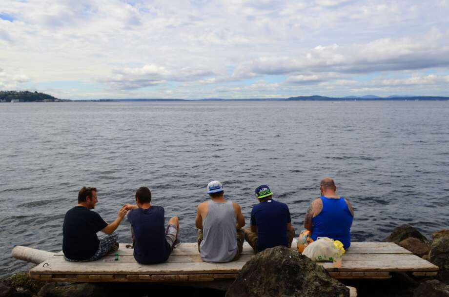 Marijuana users enjoy the view of the Puget Sound during the second day of the annual Hempfest Saturday, Aug. 17, 2013 in Seattle. This is the first year for the annual pro-pot rally since Washington State voters legalized recreational use of marijuana. (Sy Bean, seattlepi.com) Photo: SY BEAN, SEATTLEPI.COM