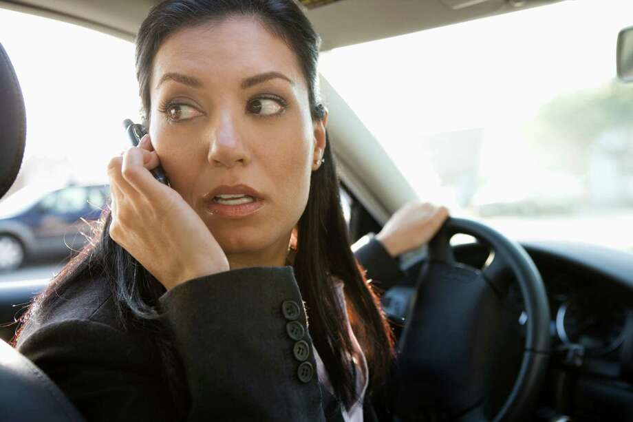 """Why it'll get you stopped:""""Distracted driving, usually because of texting or talking on a mobile phone, is high on the list of ticket bait developed by our experts.""""Source:Edmunds Photo: Siri Stafford, Getty Images / (c) Siri Stafford"""