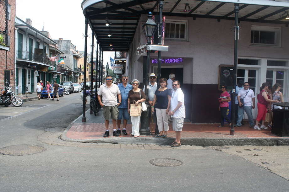 Now:Thirty-two years after taking a photo on the corner of St. Peter and Bourbon Streets in 1975 New Orleans, the Rodriguez clan recreated the original. They are (from left): Tom, Manuel, mom Delia, John, Diana and David. Photo: Handout, Rodriguez, Reader Submission