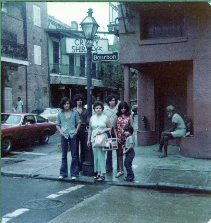 Then: In 1975 the Rodriguez family from San Antonio stopped in New Orleans on their way back from a Disney World vacation. They took this photo on the corner of Bourbon Street and St. Peter. They are (from left): Tom, Manuel, mom Delia, John, Diana and David. Photo: Handout, Rodriguez, Reader Submission