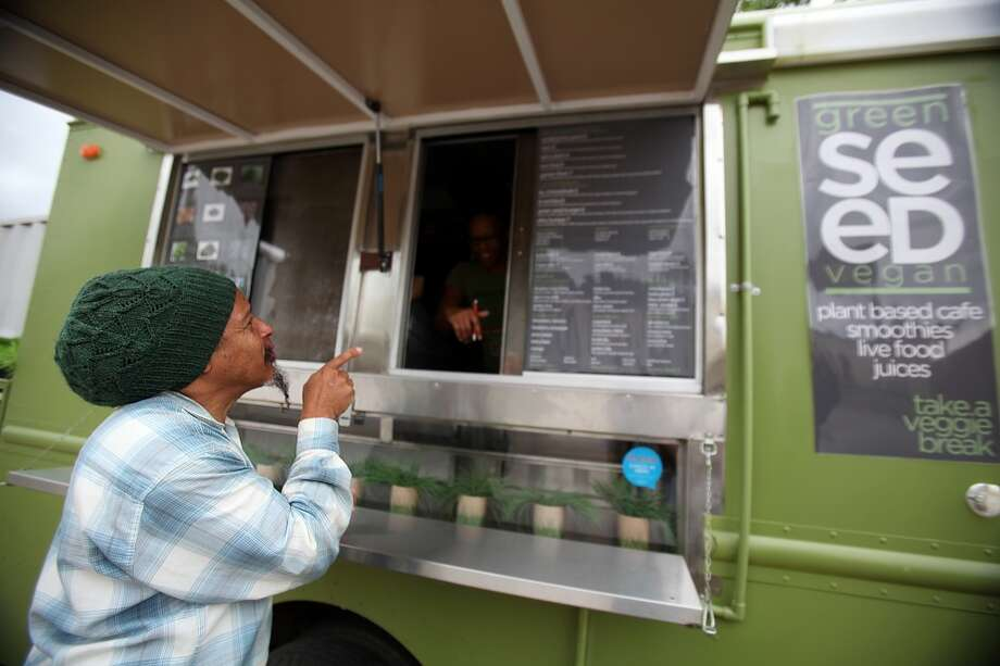 Green Seed vegan food truck, seen here in 2011, is one of several Houston food trucks that are putting down concrete roots.Read more about local food trucks' shift from wheels to permanent walls. Photo: Mayra Beltran, Houston Chronicle