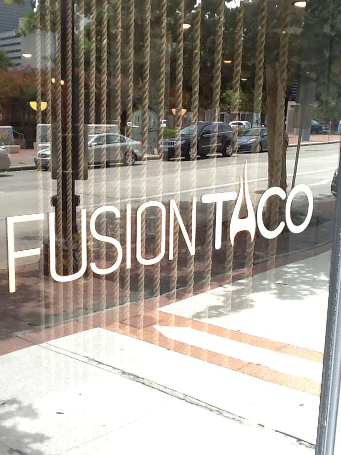 The door to the new Fusion Taco in downtown Houston located in Market Square. Photo: Greg Morago / Greg Morago