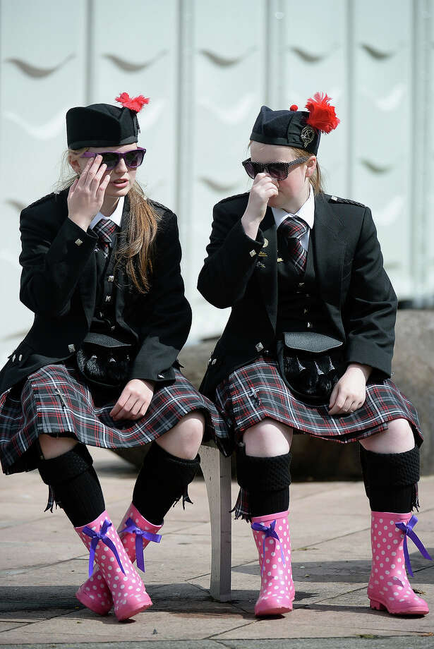 Two band members wear wellies as pipe bands take part in 2013 World Pipe Band Championships at Glasgow Green on August 18,2013 in Glasgow,Scotland. The World Pipe Band Championships has returned to Glasgow this weekend, with 225 pipe bands competing for the title. Photo: Jeff J Mitchell, Getty Images / 2013 Getty Images