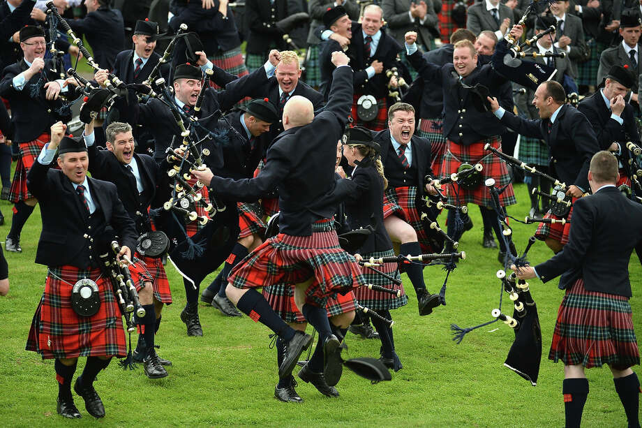 Field Marshall Montgomery celebrate winning the  2013 World Pipe Band Championships for the third year in a row at Glasgow Green on August 18,2013 in Glasgow,Scotland. The World Pipe Band Championships has returned to Glasgow this weekend, with 225 pipe bands competing for the title. Photo: Jeff J Mitchell, Getty Images / 2013 Getty Images
