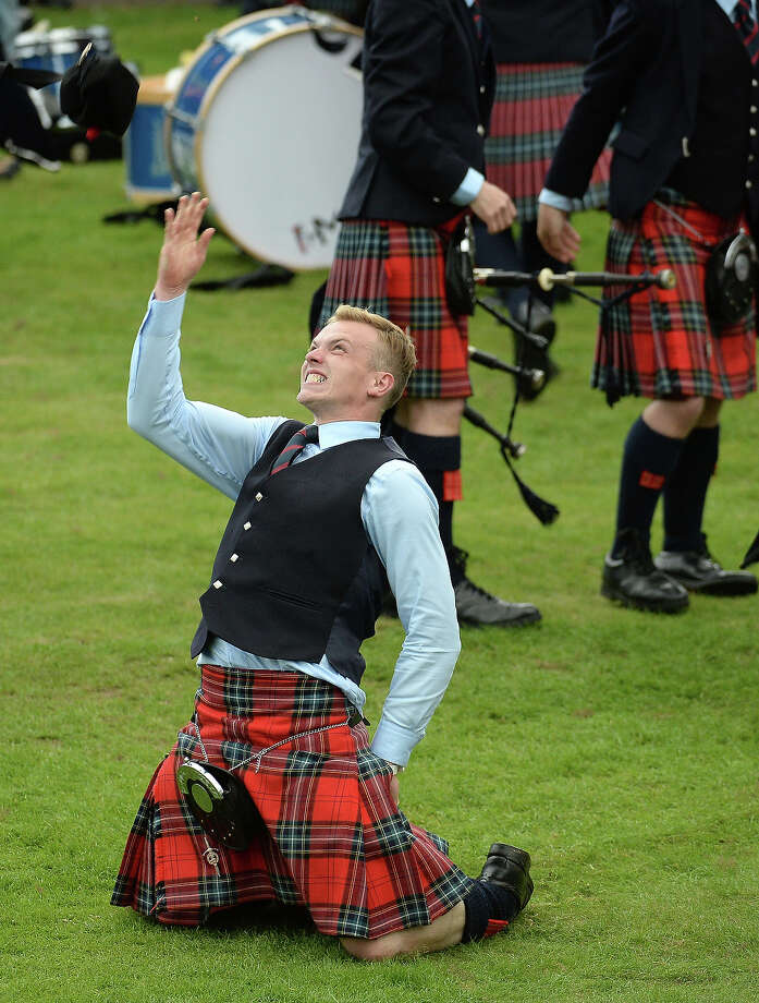 Field Marshall Montgomery celebrate winning the  2013 World Pipe Band Championships for the third year in a row at Glasgow Green on August 18, 2013 in Glasgow, Scotland. The annual World Pipe Band Championships has returned to Glasgow this weekend, with 225 pipe bands competing for the title. Photo: Jeff J Mitchell, Getty Images / 2013 Getty Images