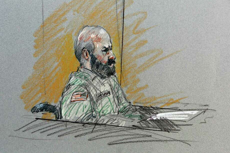 FILE- In this Aug. 6, 2013, file courtroom sketch, Maj. Nidal Malik Hasan sits in court for his court-martial in Fort Hood, Texas. The prosecutors pursuing the death penalty against the Army psychiatrist accused in the 2009 Fort Hood shooting rampage will soon begin trying to answer a difficult but key question_ determining why Hasan attacked his fellow soldiers in the worst mass shooting ever on a U.S. military base. Photo: Brigitte Woosley