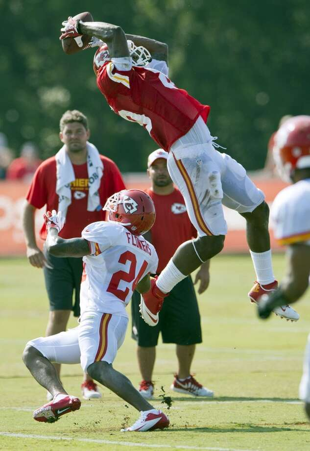 Chiefs wide receiver Jon Baldwin (89) makes a leaping catch over Chiefs cornerback Brandon Flowers (24) during morning practice at Kansas City's summer training camp. Photo: David Eulitt, McClatchy-Tribune News Service
