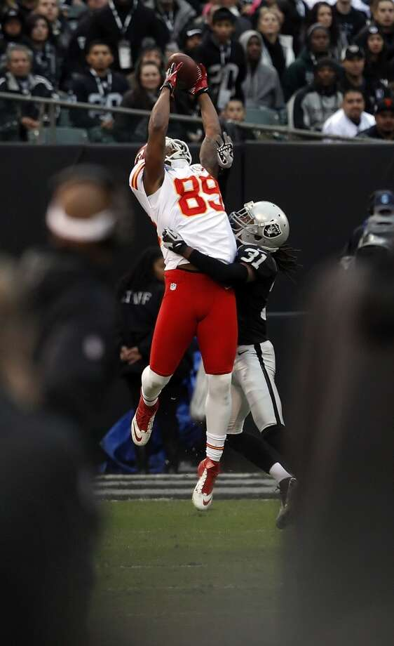 Jon Baldwin of the Chiefs can't catch a ball from Brady Quinn under pressure from Coye Francies in the fourth quarter. The Oakland Raiders played the Kansas City Chiefs at O.co Coliseum in Oakland, Calif., on Sunday, December 16, 2012. Photo: Carlos Avila Gonzalez, The Chronicle