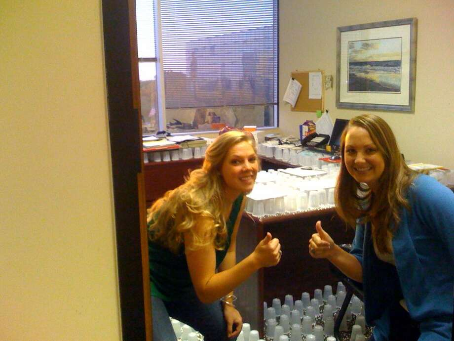 "At TXL Mortgage, loan officer Matt Brodd had a bad habit of leaving his plastic water cups on colleagues' desks. But Trish Weir, right, and Colleen Dillard got him back: In 2009, they filled Brodd's whole office with plastic cups and ""confetti"" from the office hole punch. Photo: Trish Weir"