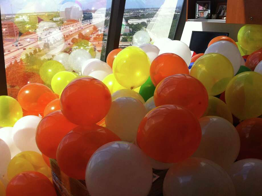 "Courtney Velek, a marketing manager at Money Management International, came back from maternity leave in 2011 to find her office filled 4 feet deep with balloons and beach balls. ""It took us an hour to discard of all of the beach balls and pop the balloons,"" she says. Photo: Courtney Velek"