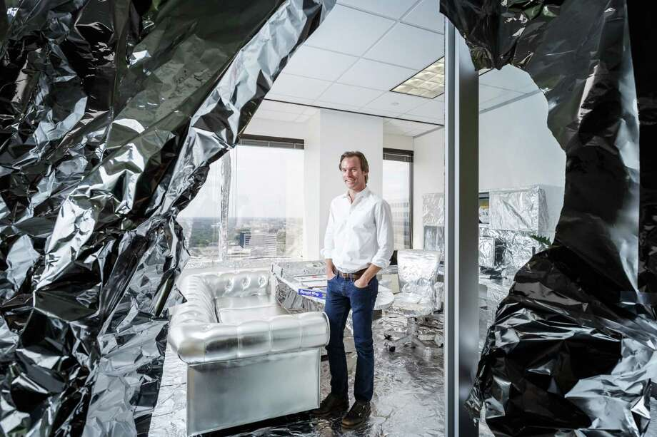 Scott Brown, President and Chief Creative Officer of advertising agency FKM, stands inside his office that was recently wrapped in aluminum foil by coworkers as an office prank, Friday, Aug. 2, 2013, in Houston. Photo: Michael Paulsen, Houston Chronicle / © 2013 Houston Chronicle