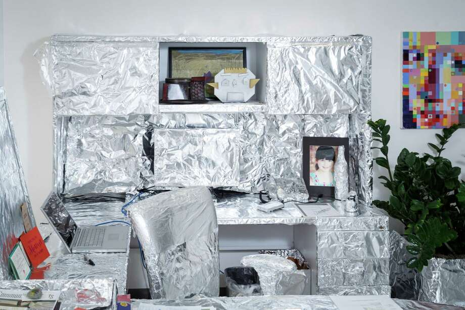 Scott Brown, President and Chief Creative Officer of advertising agency FKM, recently had his office wrapped in aluminum foil by coworkers as an office prank, Friday, Aug. 2, 2013, in Houston. Photo: Michael Paulsen, Houston Chronicle / © 2013 Houston Chronicle