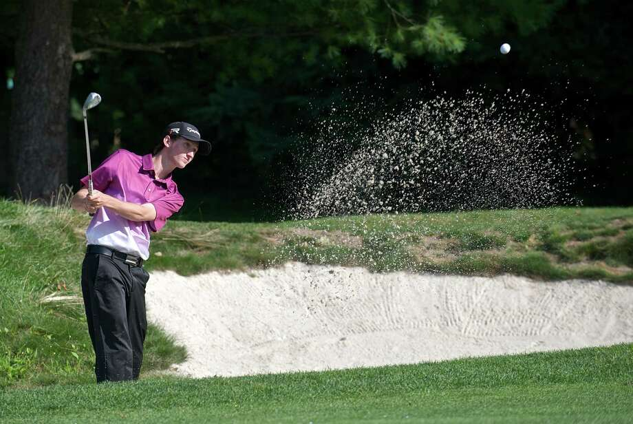 Jacob Henny, 17, of Norwalk, Conn, hits out of a bunker on the 3rd hole during the Fran McCarthy Junior Golf Championships, at Richter Park Golf Course, Monday August 19, 2013, in Danbury, Conn. Photo: H John Voorhees III