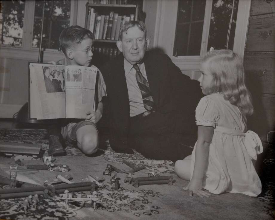 Former governor William Hobby and his two children in the upstairs east bedroom of 2115 Glen Haven.  An intimate photo with daddy on the floor with his kids. Photo: David Atkins, John Daugherty Realtors