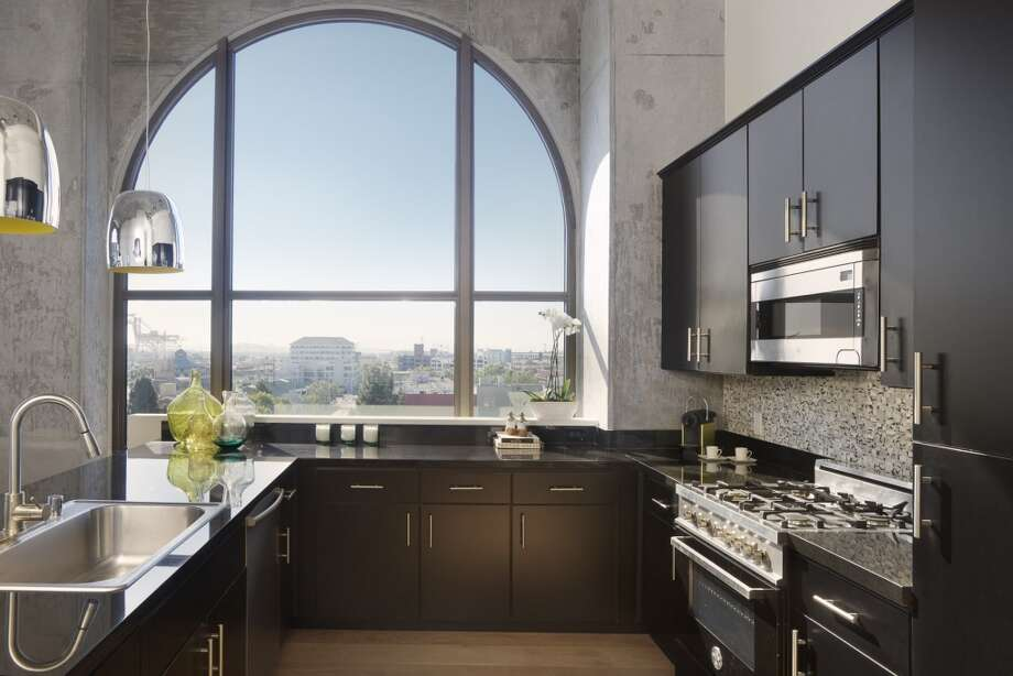 Arched windows adorn select upper-floor homes at Bond, for a kitchen-with-a-view. Photo: Patrik Argast, Patrik Argast, Courtesy Of PolarisPacific