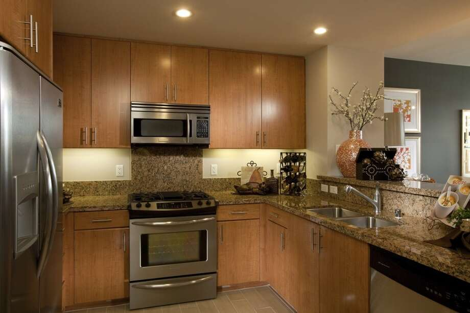 High-end cabinets and finishes, along with energy-efficient appliances, add to the design flair at Broadway Grand. Photo: Courtesy Of PolarisPacific