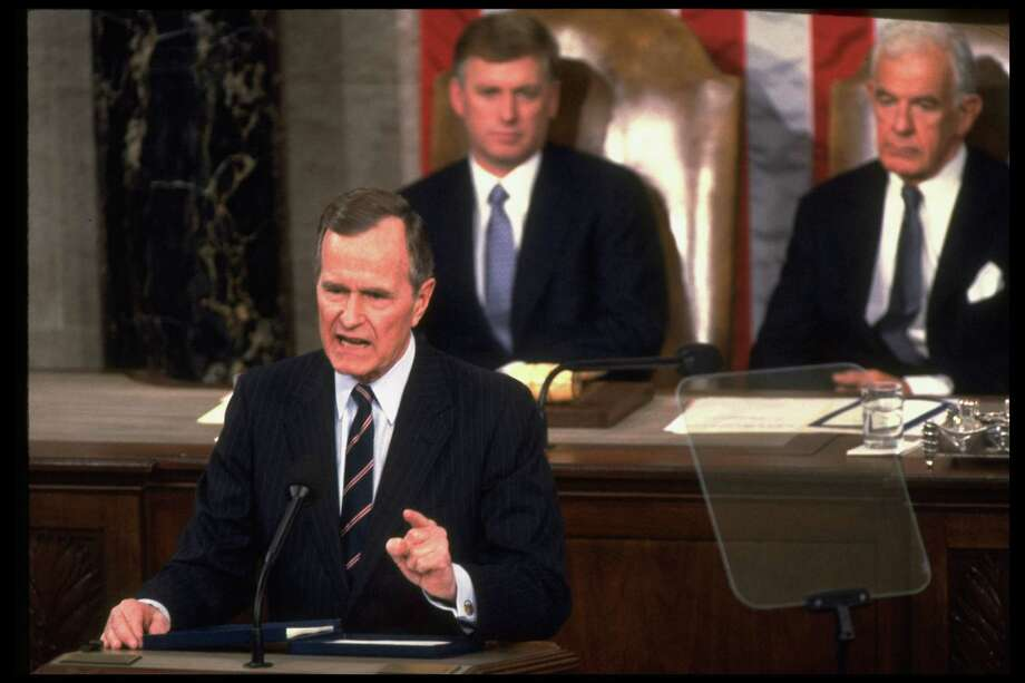 President George Bush delivering his State of Union address, framed by Vice President Dan Quayle and Speaker of the House Tom Foley. Photo: Diana Walker, Getty / Diana Walker
