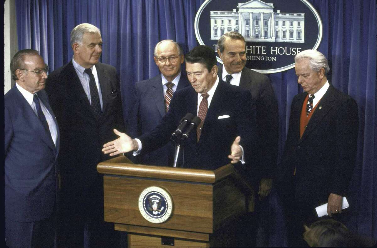 Announcement of the new federal budget including President Ronald W. Reagan at podium with (L-R) House Speaker Jim Wright., Reps. Tom Foley and Robert H. Michel, Sens. Robert J. Dole and Robert C. Byrd standing behind him.