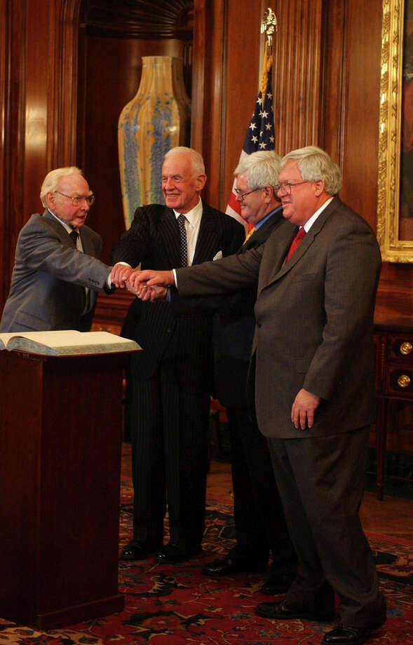 "Former House Speakers, Jim Wright, Tom Foley, Newt Gingrich, and current Speaker Dennis Hastert join hands after participating in ""The Changing Nature of the House Speakership."" Photo: Tom Williams, Getty / Roll Call"