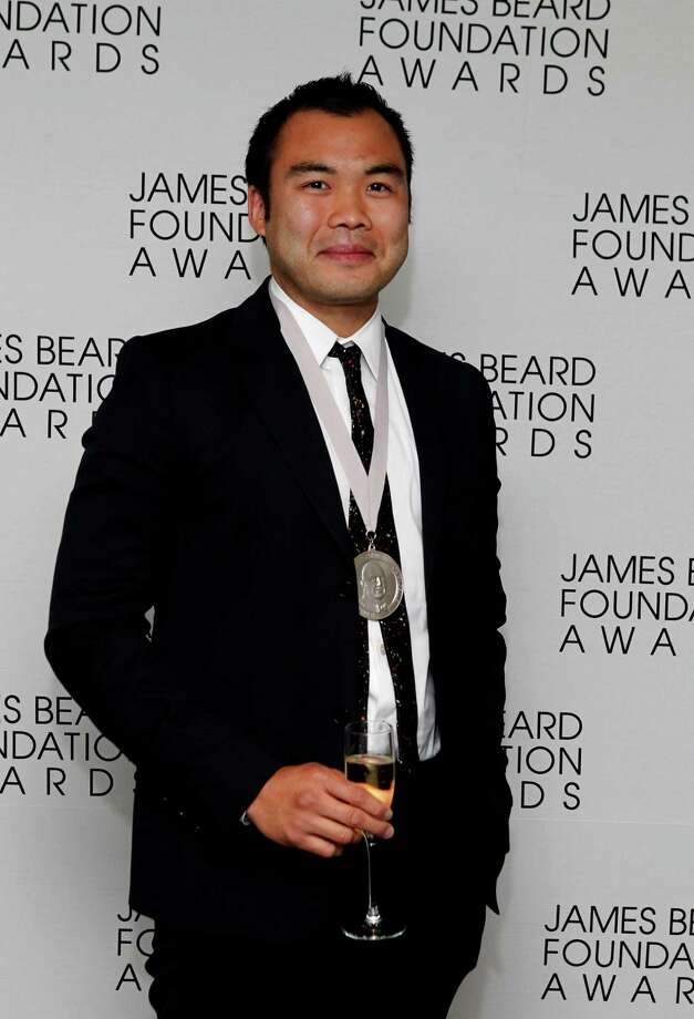 Chef Paul Qui poses with his medal for Best Chef: Southeast, during the James Beard Foundation Awards, Monday, May 7, 2012, in New York. (AP Photo/Jason DeCrow) Photo: Jason DeCrow, Associated Press / FR103966 AP
