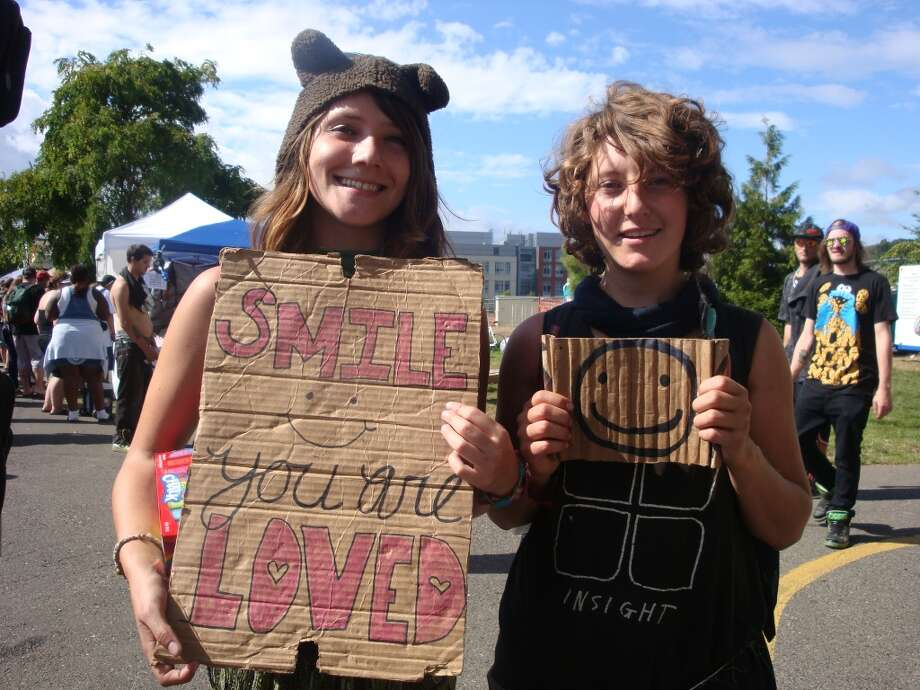 Two young travelers convened at Seattle Hempfest to spread a positive message to the marijuana masses. Photo: Ben Livingston