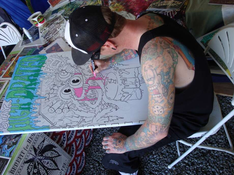 This artist worked the entire Seattle Hempfest weekend producing pot posters promoting good health and harm reduction. Photo: Ben Livingston