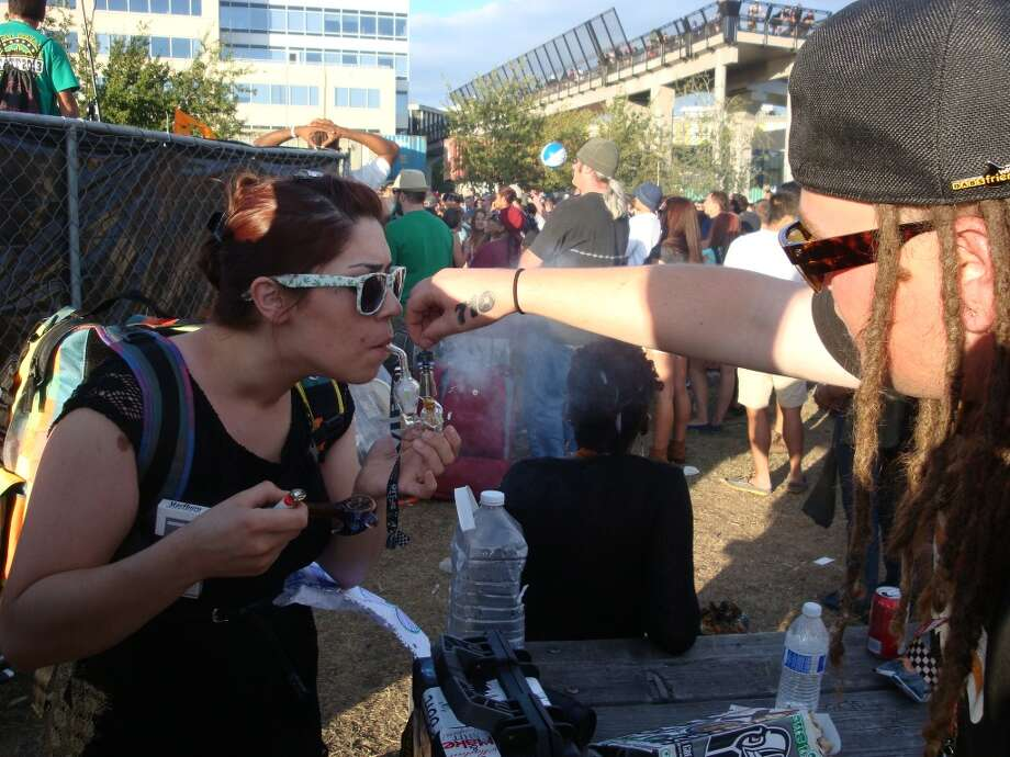 A group of hash oil aficionados commandeered a picnic table to create a free public dab station in front of the Seattle Hempfest main stage. Photo: Ben Livingston
