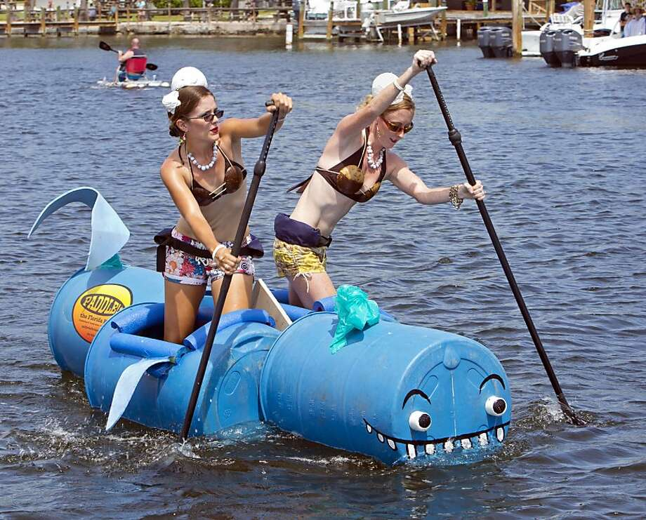 Barnacle belles: Sara Fleming (left) and Tricia Quigley-Regan paddle their 