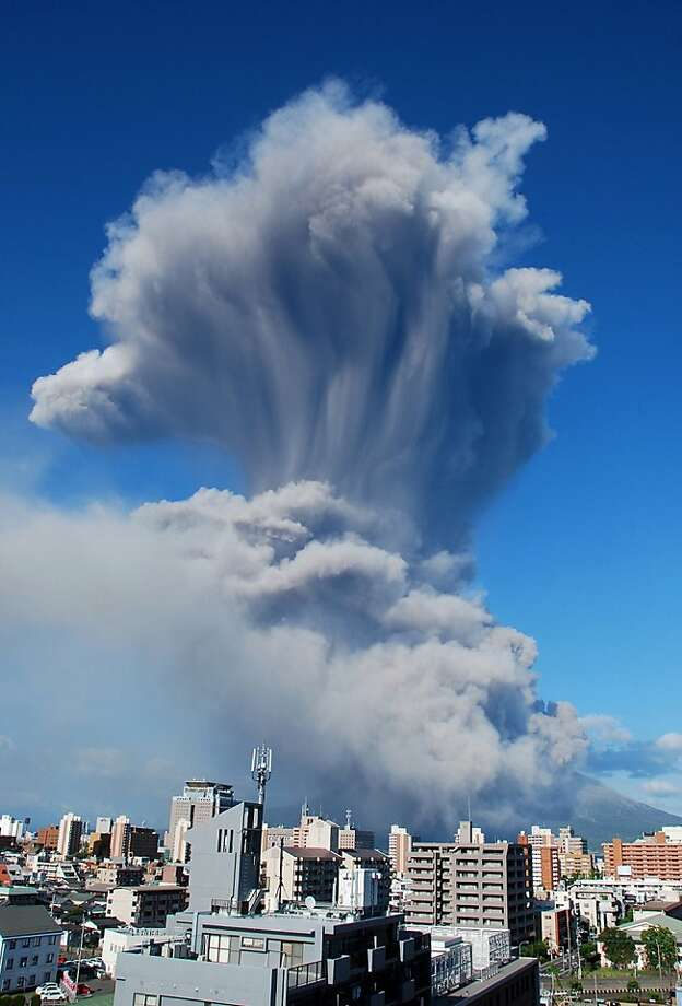 Is it time to flee yet?Ash, smoke and steam rise from 1,117-meter Mount Sakurajima at   Kagoshima in Japan's southern island of Kyushu. The volcano erupted an ash plume up to   5,000 meters into the air. Photo: Japan Meteorological Agency, AFP/Getty Images