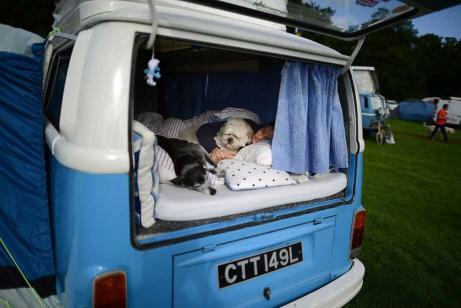 "Happy campers: At the ""In Praise Of All Things VW"" festival in Leeds, England, all sorts of Volkswagens can be found, including Jo Thompson's vintage van, which comfortable sleeps Jo, Basil and Bojangles. Photo: Nigel Roddis, Getty Images"
