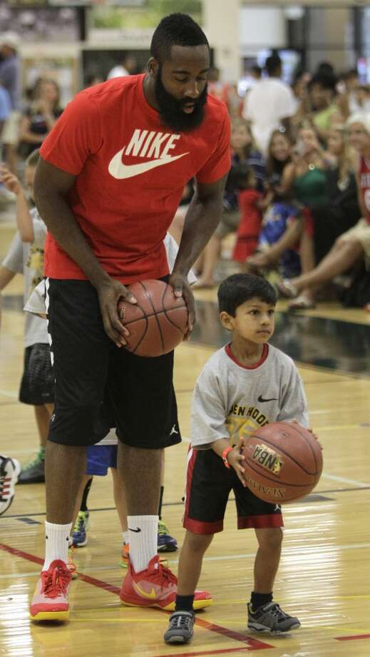 James Harden watches as Anand Julapalli, 5, of The Woodlands tries to shoot during drills at his basketball camp Monday at the Legends Sports Complex in The Woodlands. Photo: Melissa Phillip, Chronicle