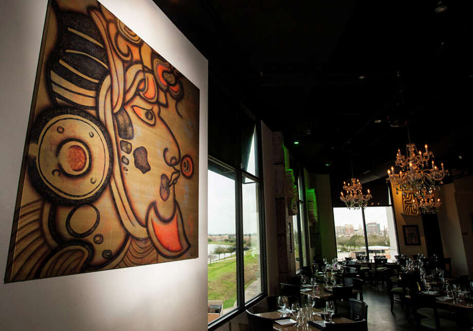 Alejandra Garza's original artwork decorates the dining area of Musas Sports Bar. Photo: Nick De La Torre, Chronicle / © 2010 Houston Chronicle
